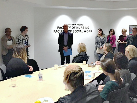 Dr. Thomas Chase, U of R Vice President (Academic), meets with faculty and staff from the faculties of nursing and social work at the grand opening of shared space in Saskatoon.